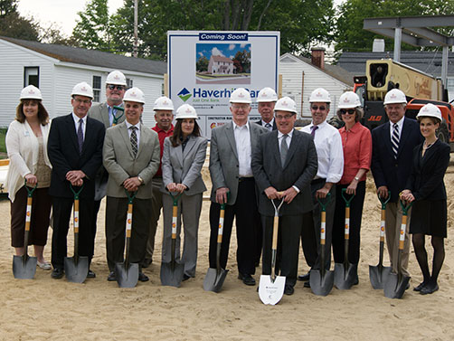 Small Business Banking Group wearing construction helmet and holding tools