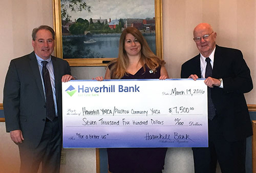 YMCA Regional Executive Director Tracy Fuller accepts a check from Haverhill Bank President and CEO