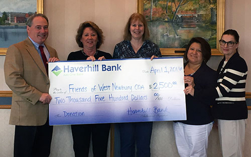 Haverhill Bank President & CEO handing check to friends of the West Newbury Council on Aging